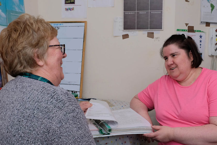 A staff member giving advice to a resident.