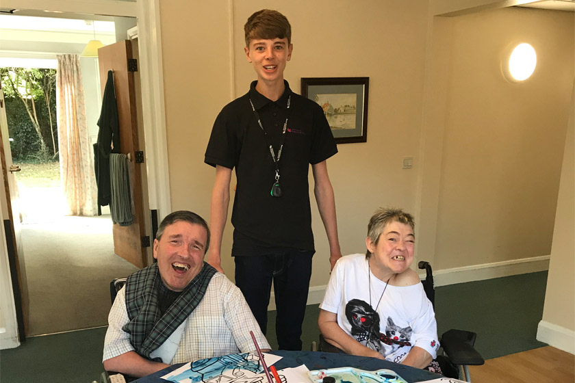 Sanctuary Supported living apprentice Adam Elliot with residents