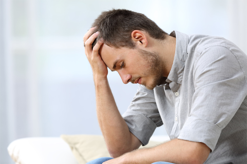 Stock image of a man feeling sad