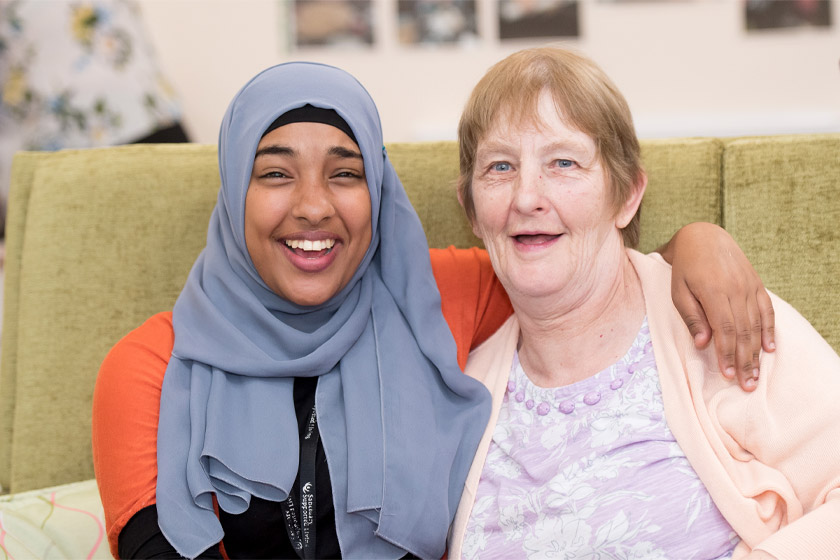 Sanctuary Supported Living staff smiling with resident