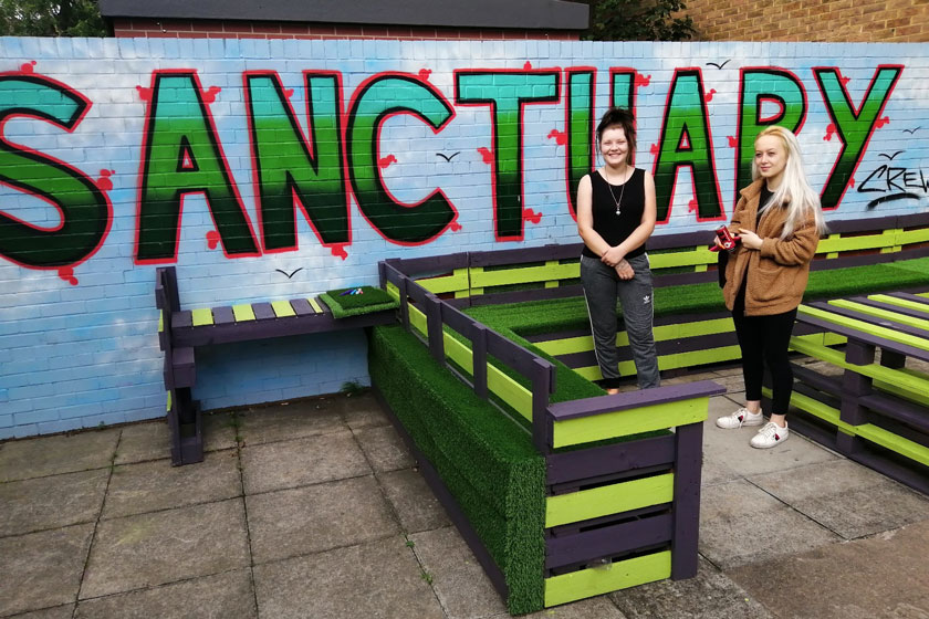 Two Victoria Road residents with the wooden pallet garden furniture.