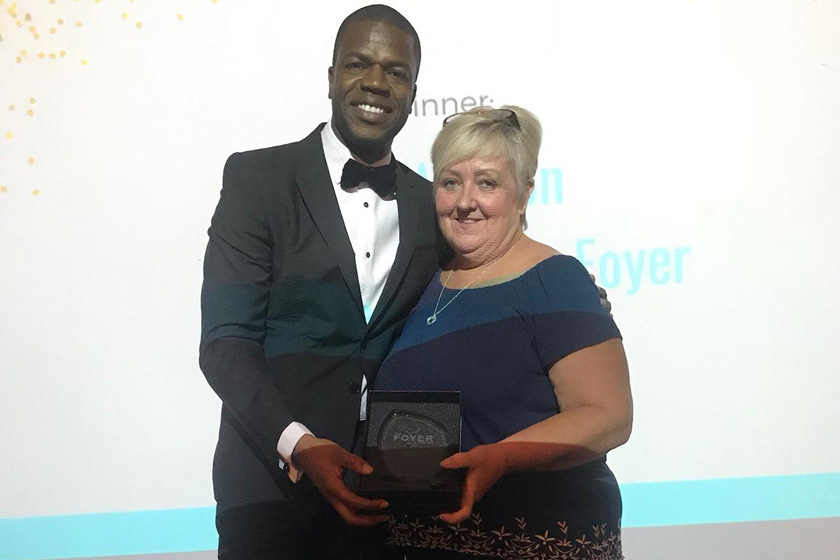 Jan Weston collecting her award from Foyer Federation CEO Tokunbo Ajasa-Oluwa