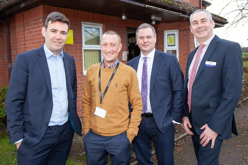 Mayor of Greater Manchester Andy Burnham with (l-r) local service manager John Cluskey, Sanctuary Group chief executive Craig Moule and head of growth and business development David Shaw.