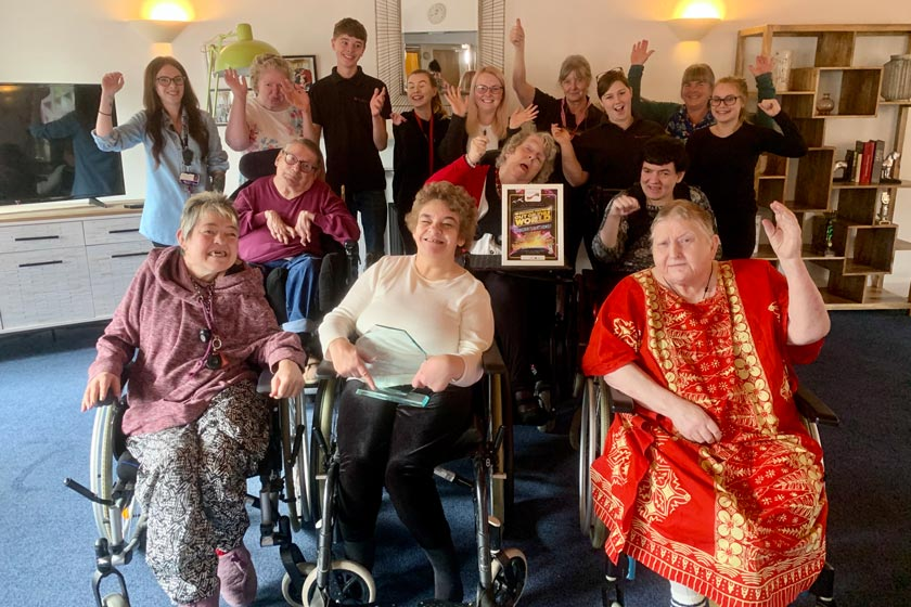 West Suffolk College students with Hilltop House residents and staff