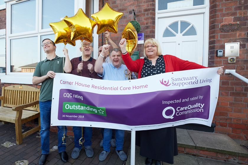 Local service manager and residents outside Corner House celebrating their 'Outstanding' rating.