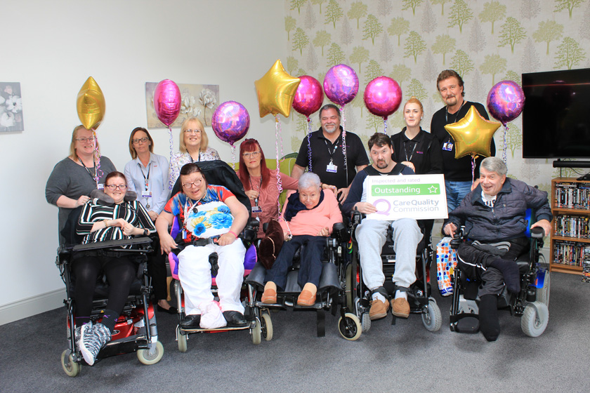 Staff and residents celebrating at Clover Court