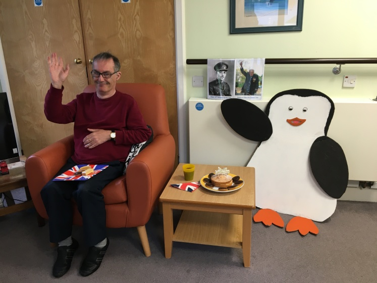 Resident Steve Aust with Smiley the Penguin