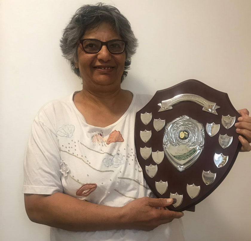 Usha with her darts sheild