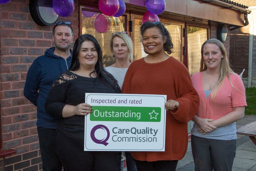 Staff from Tilmore Gardens celebrating the Outstanding CQC rating.