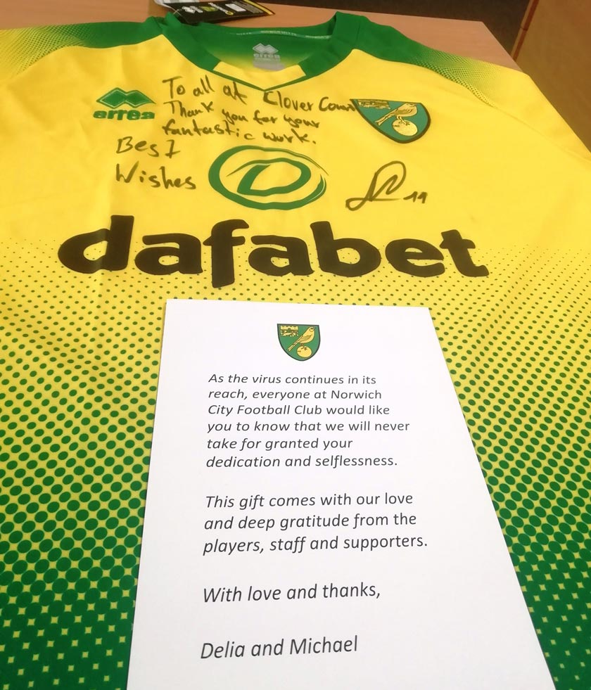 The Norwich City signed shirt and thank you card.