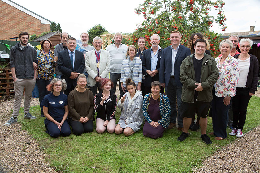 Will Quince MP (sixth from right) with residents, staff and partners of Queen Elizabeth Way