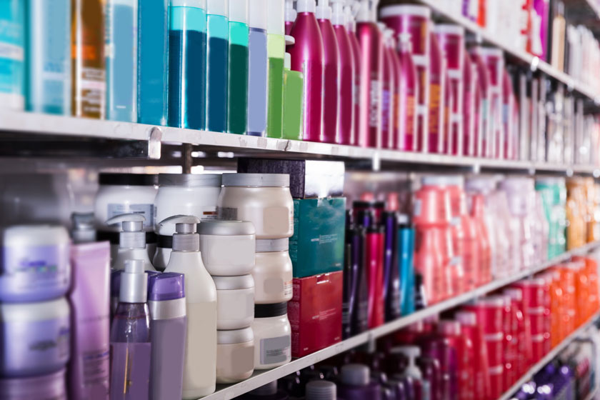 An image of toiletries lined up on shelves in a shop.