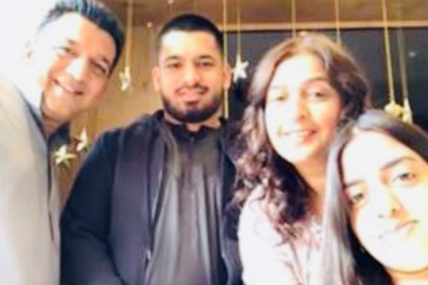 Aysha Hajat poses for a photo with her family