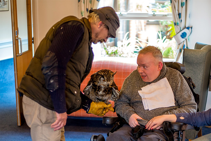 A resident at Hilltop House meeting an owl