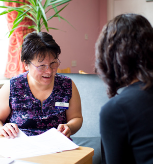 A Sanctuary Supported Living staff member talking with someone.