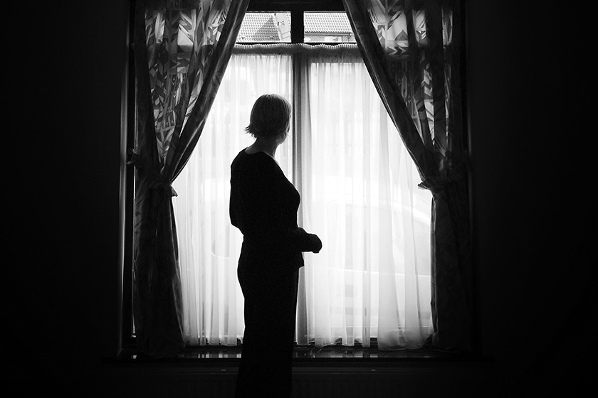 Silhouette of a woman in front of a window