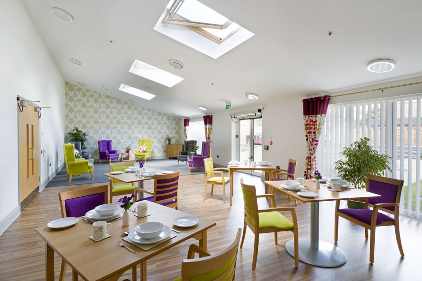 An example of a communal lounge and dining area in one of our residential homes.