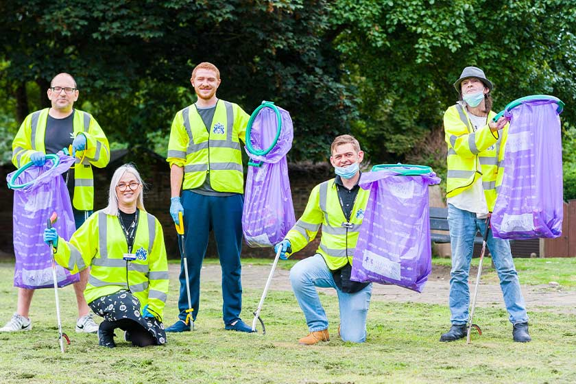 Merchant's Terrace residents and staff cleaning up their local area