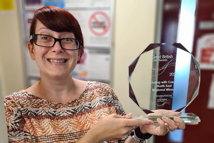 Heather Davies holding her award from the Great British Care Awards