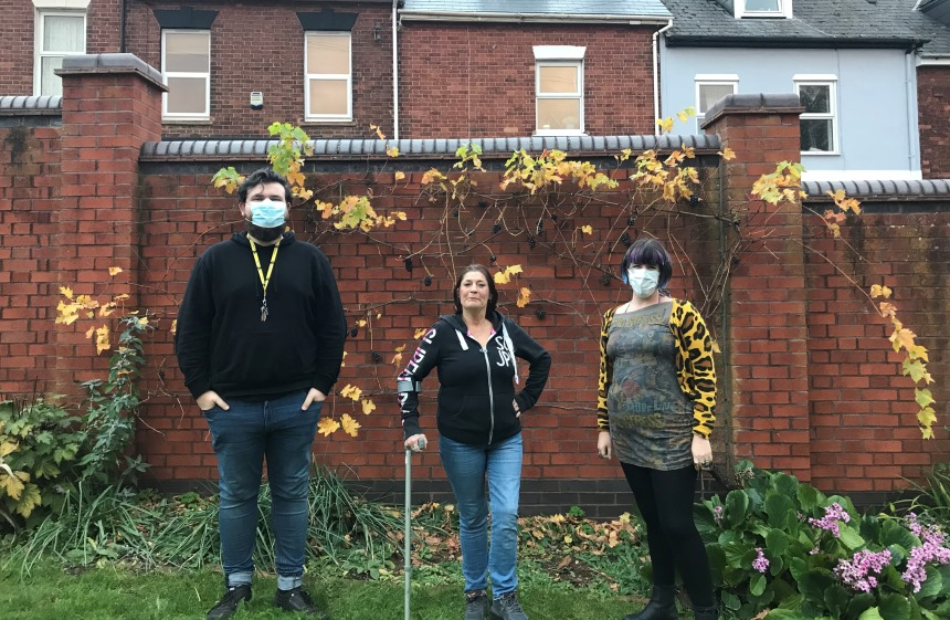 Residents and staff pose for a photo in Howell Road's garden