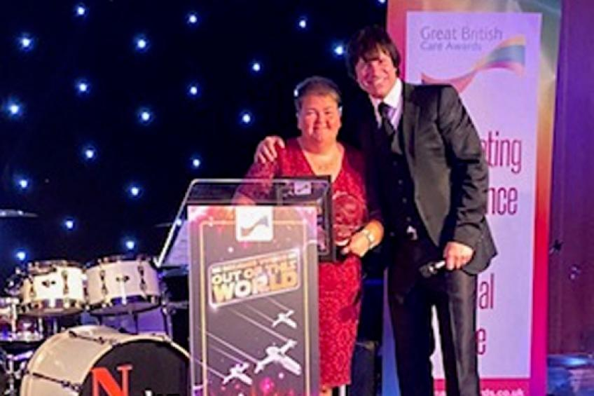 A picture of Stockton project worker scoops regional care award