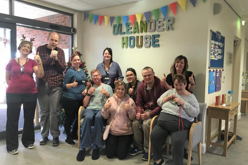 A picture of Oleander House celebrates 'Good' rating from the CQC