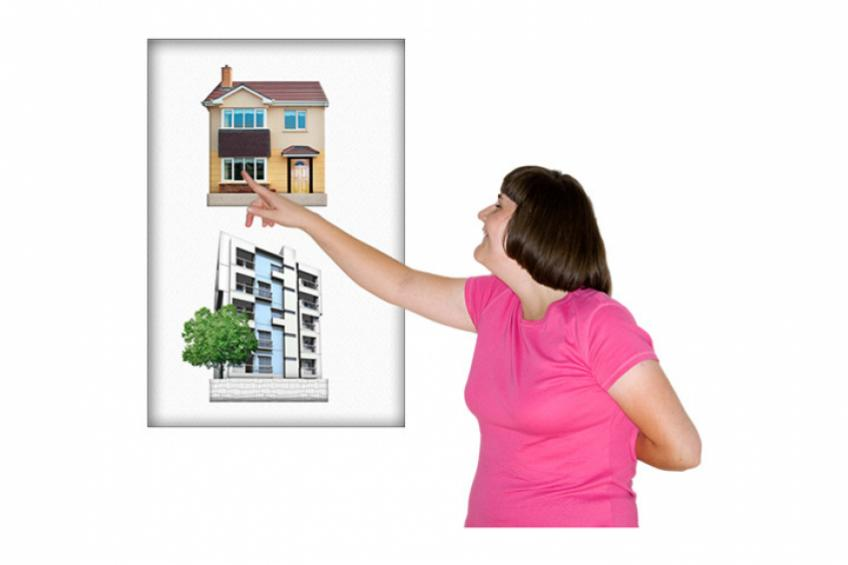A woman pointing at a home she would like to live in