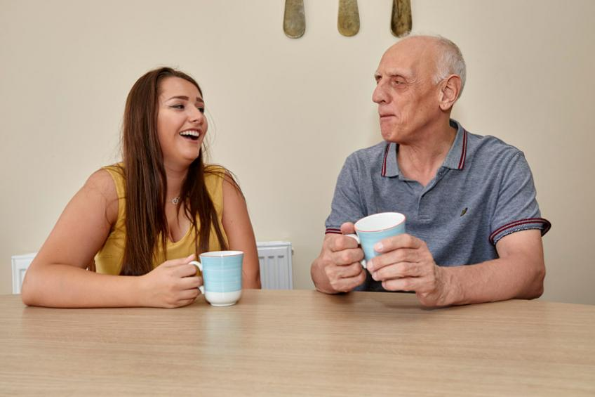 A staff member speaking to a service user at Corner House floating support.