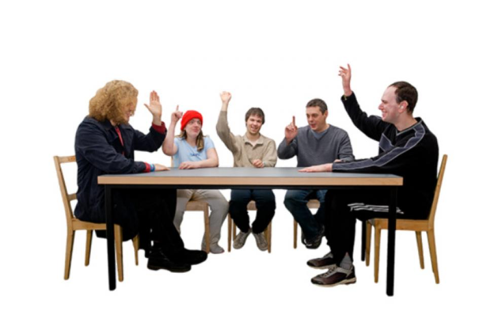 People taking a vote in a meeting
