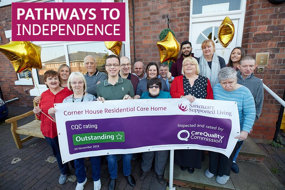Staff and residents from Corner House celebrating their outstanding CQC rating.